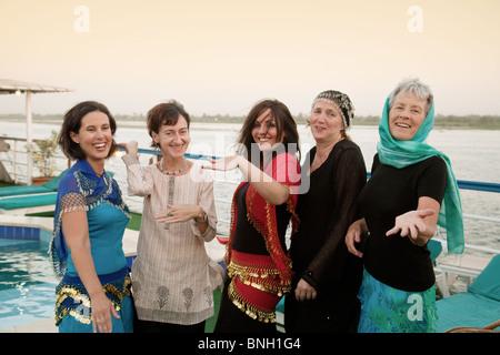 Western tourists enjoying themselves on a Nile cruise, Egypt - Stock Photo