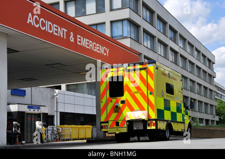 Ambulances at hospital entrance for Accident & Emergency department includes people - Stock Photo