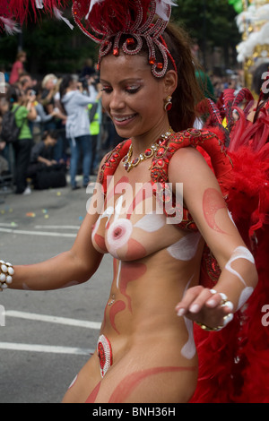 A woman samba dancer at Notting Hill Carnival, London - Stock Photo