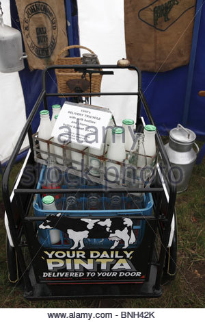Old dairy equipment display at  Masham Steam Engine & Fair Organ Rally July 2010 Masham North Yorkshire England - Stock Photo