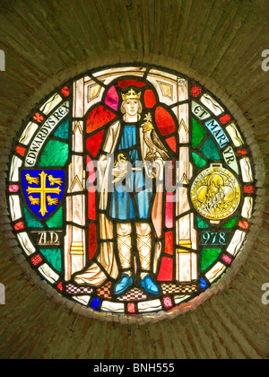 Stained Glass roundel dedicated to King Edward and Martyr at Shaftesbury Abbey ruins Dorset England UK - Stock Photo