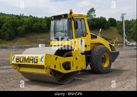 Bomag BW 213 DH roller on construction site at former steelworks site in Ebbw Vale Blaenau Gwent South Wales UK - Stock Photo