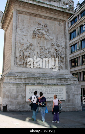 Tourists - The Monument to great fire of London (west panel) - City of London - Stock Photo
