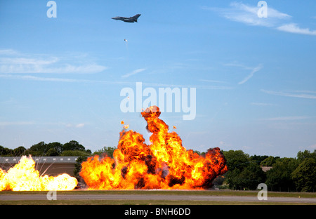 F16 fighter jet staged bombing at biggin hill airshow - Stock Photo