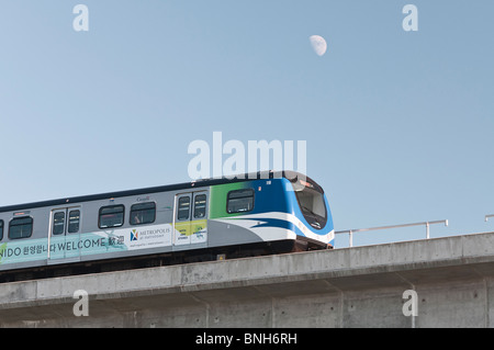 A public transit SkyTrain car on the Canada Line travelling to Vancouver International Airport. - Stock Photo