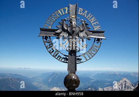 The Zugspitze Railway's crest with the Tyrolean cross on the summit of Zugspitze, Garmisch-Partenkirchen, Bavaris, - Stock Photo