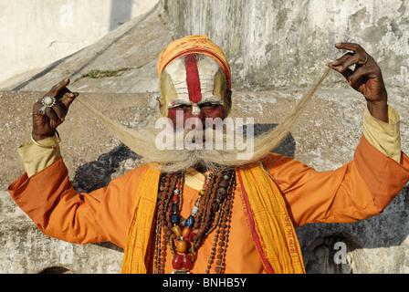 Sadhu holy man Pashupatinath Katmandu Nepal Himalayas Asia Asian asceticism ascetic ascetically beard whiskers painted - Stock Photo