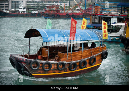 Hong Kong,  Small sampan boat for local transport in Aberdeen Harbour. - Stock Photo