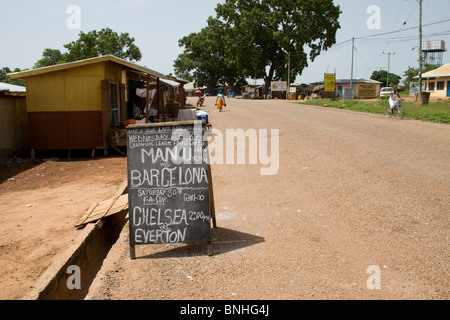 Advertisement for a bar in a small town in rural Ghana, showing the Champions League final and FA Cup final in 2009. - Stock Photo