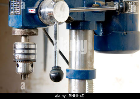 Blue drill press in a carpentry drill - Stock Photo