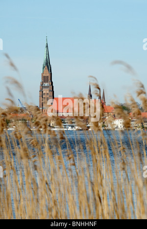View over the Schlei at the Cathedral of St Peter in Schleswig, Germany - Stock Photo