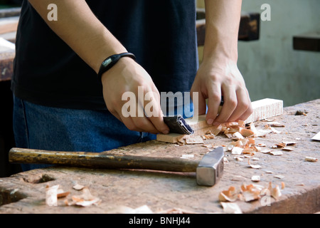 Young man doing carpentry work - Stock Photo