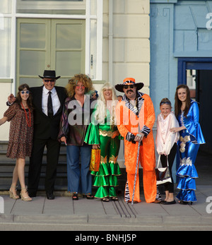 A family dressed up for a 1970's decade themed birthday party, UK - Stock Photo