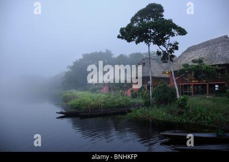 Ecuador Napo Wildlife Center Yasuni National Park Quechua Community Amazonia morning fog foggy rainforest tropical - Stock Photo