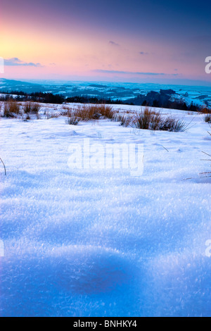 Snow fields on Black Mountain with views towards Carreg Cennen and Towy Valley Carmarthenshire Wales at sunset - Stock Photo