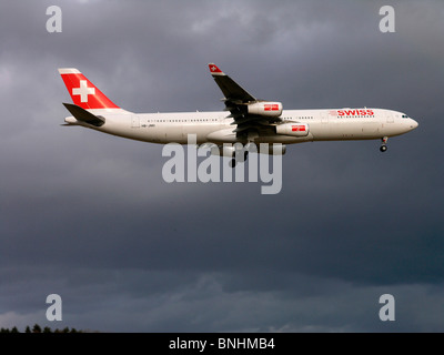 Switzerland Swiss international air lines Airbus A340 flying flight sky clouds cloudy aviation aircraft aeroplane - Stock Photo