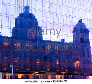 Port of Liverpool Building reflected in new Liverpool Museum Liverpool England UK at twilight - Stock Photo