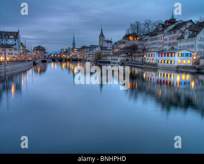 Switzerland Zurich city Town of Zürich old town Limmat river night dusk twilight lights reflections water Lindenhof - Stock Photo