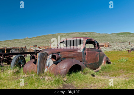 An abandoned car in Bodie State Park, California. Summer morning. - Stock Photo