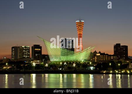 Japan Asia Kobe city Kobe port harbour port water skyline finance district evening twilight architecture - Stock Photo