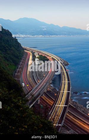 Japan Asia Tomei highway Mount Fuji Fujiyama Fuji Fujisan mountain evening twilight sea lights - Stock Photo