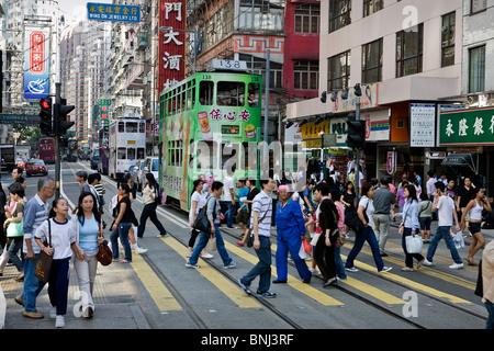 Hong Kong Hongkong Asia street traffic passer-by tram streetcar, - Stock Photo