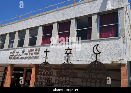 Israel, Haifa, The signs of the three major religions, Christianity, Judaism and Islam at Beit Hagefen Arab, Jewish - Stock Photo