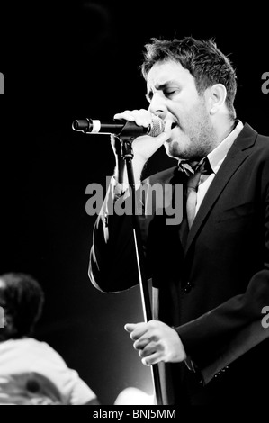 Terry Hall lead singer of The Specials on stage at Wolverhampton Civic Hall with Neville Staple in the background - Stock Photo