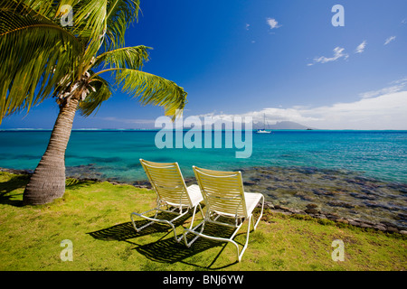 Tahiti Tahiti Nui Island Papete city sea palm deck chairs travel traveling tourism holiday vacation Pacific South - Stock Photo