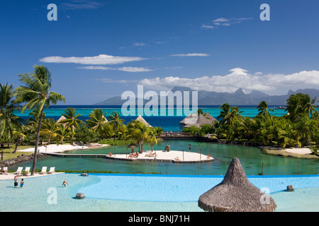 Tahiti Tahiti Nui Island Papete city sea Intercontinental Resort palms pool water traveling tourism holiday vacation - Stock Photo