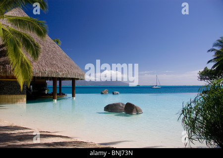 Tahiti Tahiti Nui Island Papete city sea Intercontinental Resort blue straw hut hut water traveling tourism holiday - Stock Photo