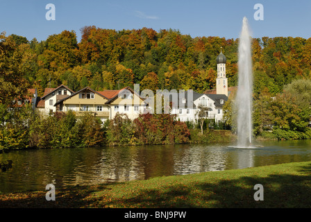 Autumn Wolfratshausen Loisach Upper Bavaria Bavaria Germany blue sky fountain Europe river stream body of water - Stock Photo