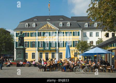 Germany North Rhine-Westphalia Bonn old postal office monument Ludwig van Beethoven Münster square street cafes - Stock Photo