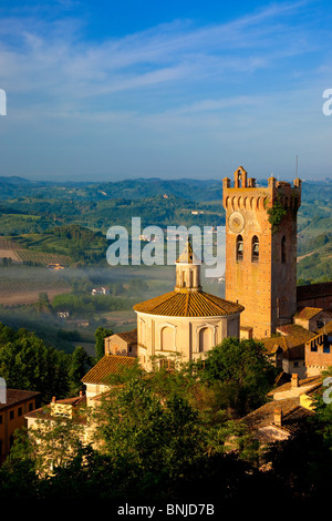 Morning mist laying in the valley below the duomo and medieval town of San Miniato, Tuscany Italy - Stock Photo