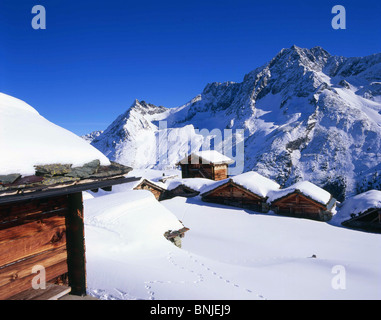 Alp Arolla alps alpine mountain mountains Mountain Snow Canton of Valais Village Winter Switzerland landscape scenery - Stock Photo