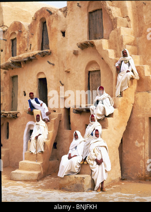 Tunisia December 2007 Near Tataouine city Ksar Ouled Sultane granary men people local building culture desert - Stock Photo