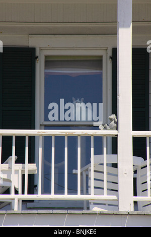 Cat looks out from window of house in Beaufort, North Carolina, USA - Stock Photo