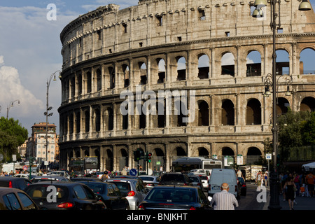 Road traffic in front of The Colosseum or Roman Coliseum, Italy. - Stock Photo