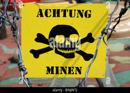 German Mine Warning Sign On Barbed Wire. - Stock Photo