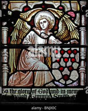A stained glass window depicting an angel holding the Shield of the Diocese of Worcester - Stock Photo