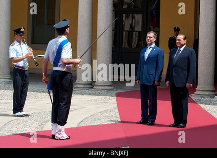 Russian President Dmitry Medvedev meets for talks with Italian Prime Minister Silvio Berlusconi in Milan, 23 July - Stock Photo