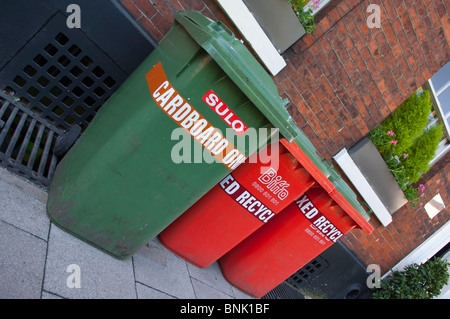 Green and red Assorted Sulo wheelie bins for recycling in the Uk - Stock Photo