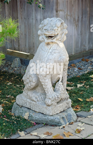 Chinese Guardian Lion statue. - Stock Photo