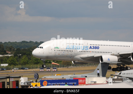The Airbus A380 super-airliner in display flight at Farnborough International Airshow 2010 - Stock Photo