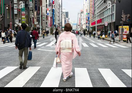 Woman wearing a kimono on Chuo-dori in Ginza 4-chome, Tokyo, Japan - Stock Photo