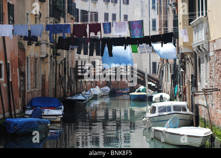 Clothes lines over a canal in the Jewish Ghetto, Venice, Italy - Stock Photo