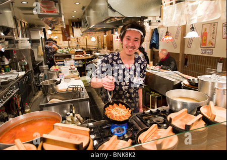 Chef cooking gyoza in traditional restaurant, Japan - Stock Photo