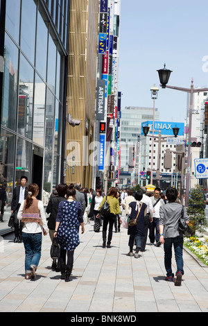 Shoppers on Chuo-dori in Ginza 4-chome, Tokyo, Japan - Stock Photo