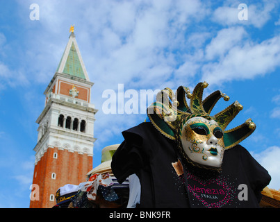 Mask and Bell tower in St Mark's square, Venice, Italy - Stock Photo