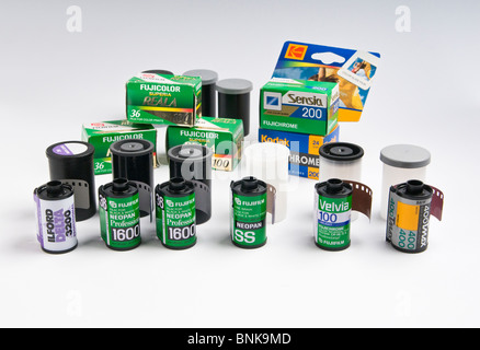 An assortment of various types of 35mm film. - Stock Photo